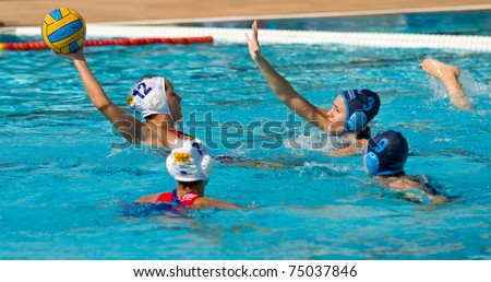BARCELONA - APRIL 10: Water polo players in action during the women Spanish league match between CN Mataro and Sant Andreu, final score 4 - 7. April 10, 2011 in Mataro (Spain).