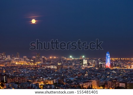 Barcelona at night with full moon and torre agbar, Catalunya, Spain - stock photo