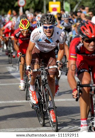 BARCELONA - AUG 26: AG2R La Mondiale Irish cyclist Nicolas Roche rides with the pack during the Vuelta Ciclista a Espana cycling race in Barcelona, Spain on August 26, 2012 - stock photo