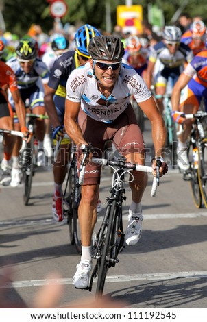 BARCELONA - AUG 26: AG2R La Mondiale Italian cyclist Rinaldo Nocentini rides with the pack during the Vuelta Ciclista a Espana cycling race in Barcelona, Spain on August 26, 2012 - stock photo