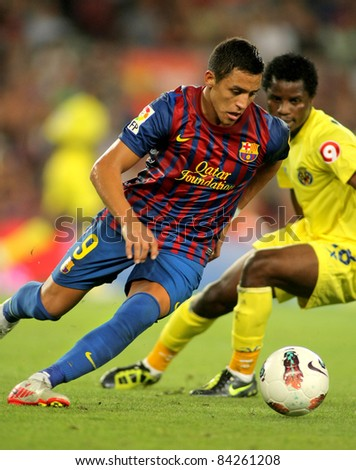 BARCELONA - AUG 29: Alexis Sanchez of FC Barcelona in action during a Spanish League match between FC Barcelona and Villarreal at the Nou Camp Stadium on August 29, 2011 in Barcelona, Spain - stock photo