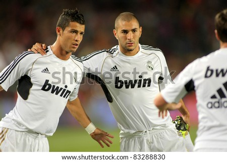 BARCELONA - AUG 17: Cristiano Ronaldo(L) and Benzema(R) of Madrid stretching before the Spanish Supercup football match against Barcelona at the New Camp Stadium in Barcelona, Spain on August 17, 2011 - stock photo