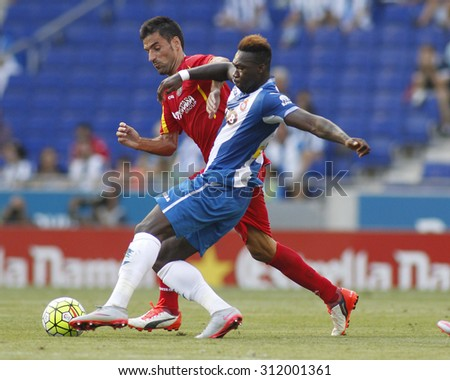 BARCELONA - AUG, 22: Felipe Caicedo(R) of Espanyol fight with Juan Rodríguez(L) of Getafe during a Spanish League match at the Power8 stadium on August 22 2015 in Barcelona Spain - stock photo