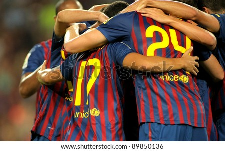 BARCELONA - AUG 22: Group of FC Barcelona players celebrate a goal during Joan Gamper Trophy match between FC Barcelona and SSC Napoli at Nou Camp Stadium in Barcelona, Spain on August 22, 2011 - stock photo