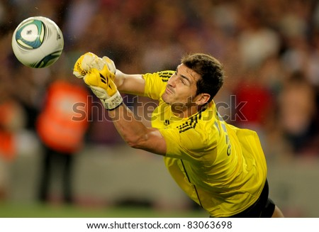 BARCELONA - AUG 17: Iker Casillas of Real Madrid throws the ball  during the Spanish Supercup football match between Barcelona vs Real Madrid at the New Camp Stadium in Barcelona, Spain on August 17, 2011 - stock photo