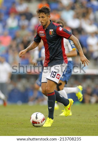BARCELONA - AUG, 17: Leandro Greco of Genoa CFC in action during a friendly match against RCD Espanyol at the Estadi Cornella on August 17, 2014 in Barcelona, Spain - stock photo