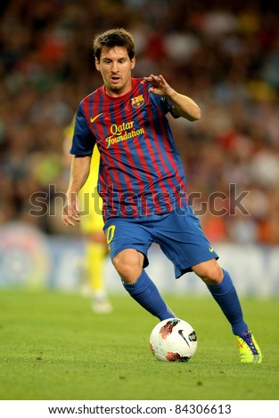 BARCELONA - AUG, 29: Leo Messi of FC Barcelona in action during a Spanish League match between FC Barcelona and Villarreal at the Nou Camp Stadium on August 29, 2011 in Barcelona, Spain - stock photo