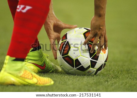 BARCELONA - AUG, 30: Player of Sevilla FC preparing to launch kick off during spanish league match against Espanyol at the Estadi Cornella on August 30, 2014 in Barcelona, Spain - stock photo