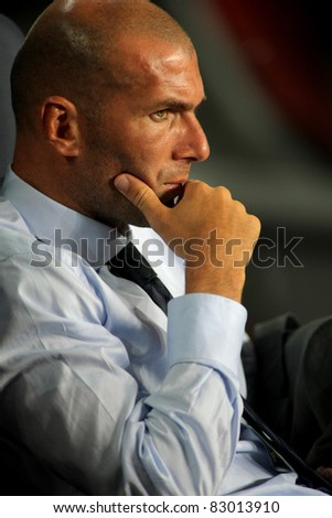 BARCELONA - AUG 17: Real Madrid Sporting Diretor Zinedine Zidane, during Spanish Supercup football match between Barcelona vs Real Madrid at the New Camp Stadium in Barcelona, on August 17, 2011 - stock photo