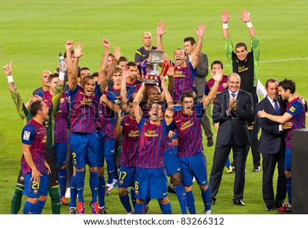 BARCELONA - AUGUST 17: Barcelona players celebrate Spanish Supercup victory after beating Real Madrid (3 - 2) on August 17, 2011 in Camp Nou, Barcelona, Spain. - stock photo