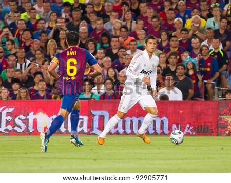 BARCELONA - AUGUST 17: Cristiano Ronaldo (R) in action during the Spanish Super Cup final match between FC Barcelona and Real Madrid, 3 - 2, on August 17, 2011 in Camp Nou stadium, Barcelona, Spain. - stock photo