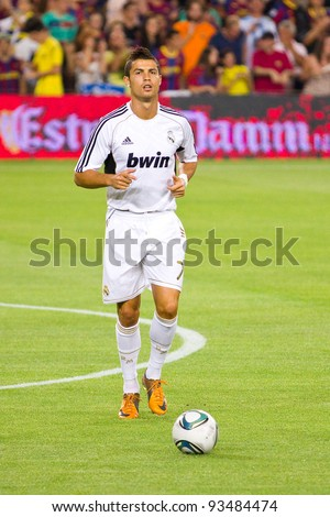 BARCELONA - AUGUST 17: Cristiano Ronaldo warms-up before the Spanish Super Cup final match between FC Barcelona and Real Madrid, 3 - 2, on August 17, 2011 in Camp Nou stadium, Barcelona, Spain. - stock photo