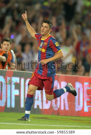 BARCELONA - AUGUST 25: David Villa of Barcelona celebrates goal Trophy Joan Gamper match between FC Barcelona and AC Milan at Nou Camp Stadium on August 25, 2010 in Barcelona, Spain. - stock photo