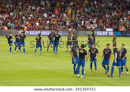 BARCELONA - AUGUST 17: FCB players in action at the Spanish Super Cup final match between FC Barcelona and Real Madrid, 3 - 2, on August 17, 2011 in Camp Nou stadium, Barcelona, Spain. - stock photo