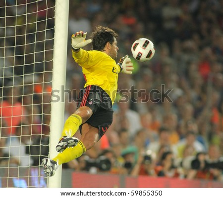 BARCELONA - AUGUST 25: Flavio Roma of AC Milan in action during Trophy Joan Gamper match between FC Barcelona and AC Milan at Nou Camp Stadium on August 25, 2010 in Barcelona, Spain. - stock photo