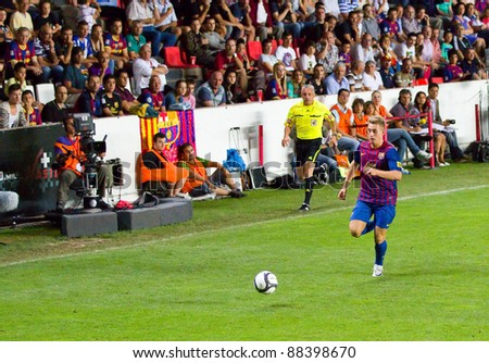 BARCELONA - AUGUST 9: Gerard Deulofeu of Barcelona in action during the Copa Catalunya Trophy final match between RCD Espanyol and FC Barcelona, 3 - 0, on August 9, 2011 in Tarragona, Spain. - stock photo