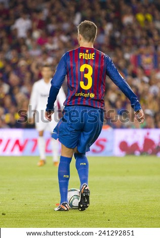 BARCELONA - AUGUST 17: Gerard Pique of FCB in action at the Spanish Super Cup final match between FC Barcelona and Real Madrid, 3 - 2, on August 17, 2011 in Camp Nou stadium, Barcelona, Spain. - stock photo