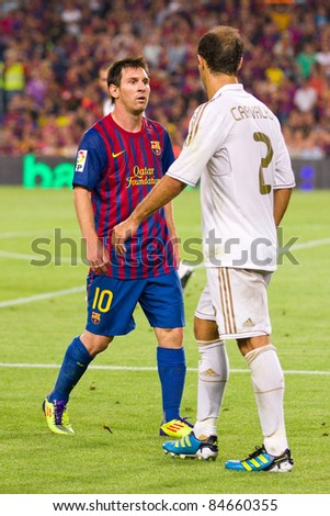BARCELONA - AUGUST 17: Leo Messi (10) and Ricardo Carvalho during the Spanish Super Cup final match between FC Barcelona and Real Madrid, final score 3 - 2, on August 17, 2011 in Barcelona, Spain. - stock photo