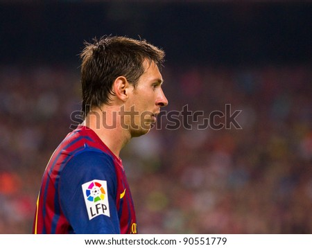BARCELONA - AUGUST 17: Leo Messi in action during the Spanish Super Cup final match between FC Barcelona and Real Madrid, 3 - 2, on August 17, 2011 in Barcelona, Spain. - stock photo