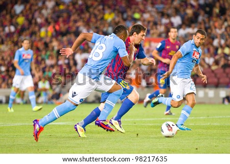 BARCELONA - AUGUST 22: Leo Messi (middle) in action during the Gamper Trophy final match between FC Barcelona and Napoli, final score 5 - 0, on August 22, 2011 in Camp Nou stadium, Barcelona, Spain. - stock photo