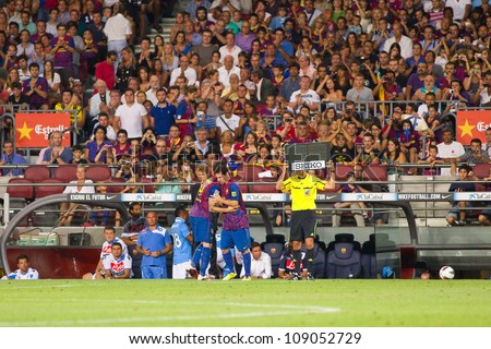 BARCELONA - AUGUST 22: Leo Messi (R) in action during the Gamper Trophy final match between FC Barcelona and Napoli, final score 5 - 0, on August 22, 2011 in Camp Nou stadium, Barcelona, Spain. - stock photo