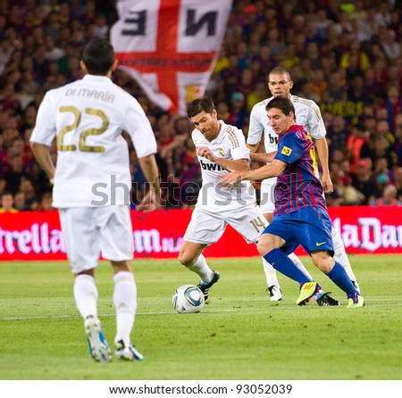 BARCELONA - AUGUST 17: Leo Messi (R) in action during the Spanish Super Cup final match between FC Barcelona and Real Madrid, final score 3 - 2, on August 17, 2011 in Camp Nou, Barcelona, Spain. - stock photo
