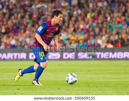BARCELONA - AUGUST 17: Lionel Messi in action during the Spanish Super Cup final match between FC Barcelona and Real Madrid, 3 - 2, on August 17, 2011 in Camp Nou stadium, Barcelona, Spain. - stock photo