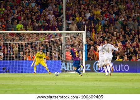 BARCELONA - AUGUST 17: Lionel Messi (middle) in action during the Spanish Super Cup final match between FC Barcelona and Real Madrid, 3 - 2, on August 17, 2011 in Camp Nou stadium, Barcelona, Spain. - stock photo
