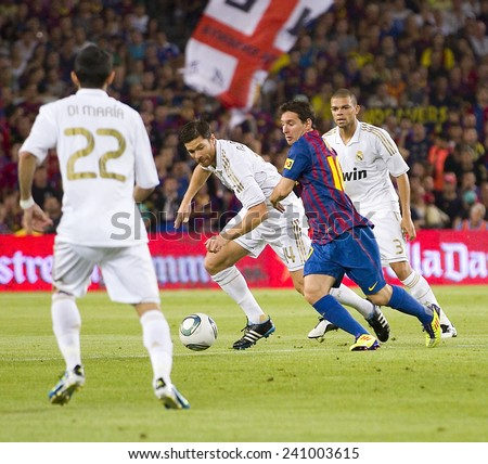 BARCELONA - AUGUST 17: Lionel Messi of FCB in action at the Spanish Super Cup final match between FC Barcelona and Real Madrid, 3 - 2, on August 17, 2011 in Camp Nou stadium, Barcelona, Spain. - stock photo
