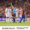 BARCELONA - AUGUST 17: Referee giving yellow card to Sami Khedira (L) during the Spanish Super Cup final match between FC Barcelona and Real Madrid, 3 - 2, on August 17, 2011 in Barcelona, Spain. - stock photo