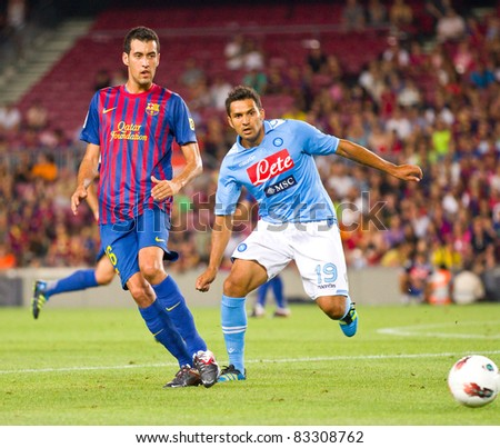 BARCELONA - AUGUST 22: Sergio Busquets (L) and Mario Santana in action during the Gamper Trophy final match between FC Barcelona and Napoli, 5 - 0, on August 22, 2011 in Camp Nou, Barcelona, Spain.