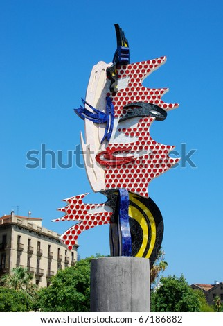 BARCELONA- AUGUST 06: The modern sculpture on August 06, 2010 in Barcelona (Spain).Barcelona's Head is a surrealist sculpture created by American Pop artist Roy Lichtenstein for the 1992 games. - stock photo