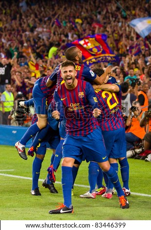 BARCELONA - AUGUST 17: Unidentified players celebrating the goal of Leo Messi during the Spanish Supercup final match between FC Barcelona & Real Madrid, 3 - 2, on August 17, 2011 in Barcelona, Spain. - stock photo