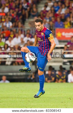 BARCELONA - AUGUST 22: Xavi Hernandez in action during the Gamper Trophy final match between FC Barcelona and SSC Napoli, final score 5 - 0, on August 22, 2011 in Camp Nou stadium, Barcelona, Spain. - stock photo