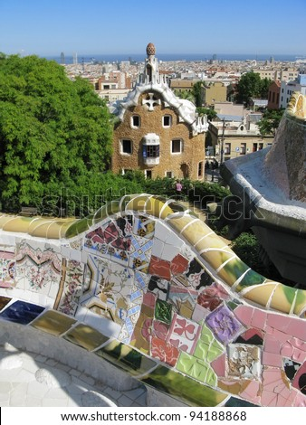 Barcelona: Beautiful seats made of ceramic mosaic tiles in Park Guell, the famous and beautiful park designed by Antoni Gaudi, one of the highlights of the city - stock photo