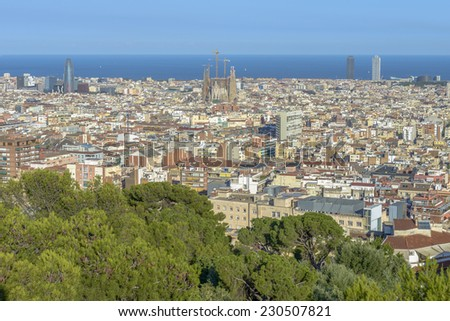 Barcelona by day seen from Parc Guell include sagrada familia, agbar tower, scyscrapers, la rambla and other