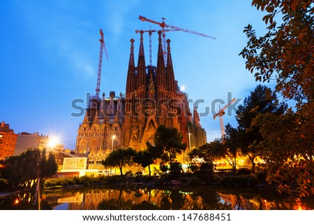 BARCELONA, CATALONIA - JULY 14: Sagrada Familia in evening in July 14, 2013 in Barcelona, Catalonia.  Famous Church in night, building is begun in 1882 and completion is planned in 2030 - stock photo