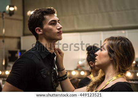 Barcelona, Catalunya / Spain - 06 29 : A male model gets the touch of a makeup artist in the backstage before the catwalk of the 080 Barcelona Fashion week on 2016/06/29 in Barcelona (Spain). - stock photo