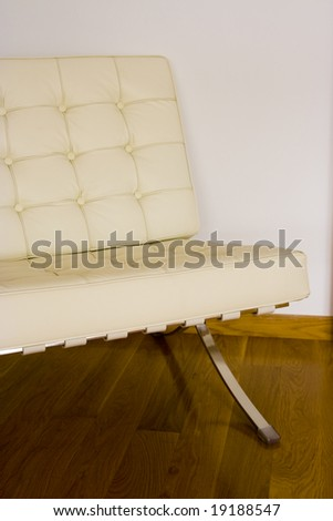 Barcelona chair on a oat wooden floor - stock photo