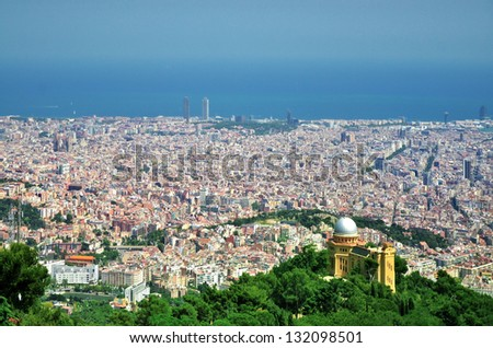 Barcelona City Panoramic view from hills under sky - stock photo