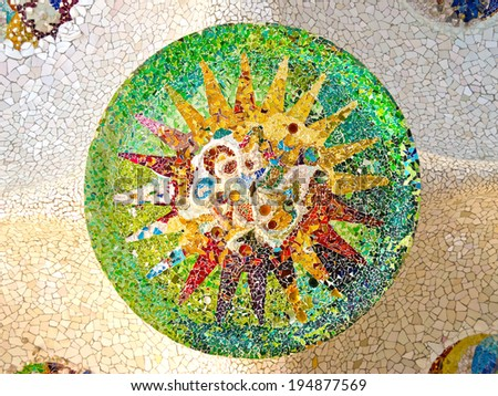 BARCELONA �¢?? DEC 27: Ceiling with mosaic sun of Park Guell designed by Antonio Gaudi on December 27, 2012 in Barcelona. Part of the UNESCO World Heritage Site Works of Antoni Gaudi.  - stock photo
