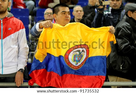 BARCELONA - DEC, 11: Colombian supporter of Atletico madrid player Radamel Falcao during a Spanish League match at the Estadi Cornella on December 11, 2011 in Barcelona, Spain - stock photo