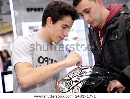 BARCELONA - DEC, 9: World champion motocycle racer Marc Marquez autograph signing in shopping center on December 9, 2014 in Barcelona, Spain - stock photo