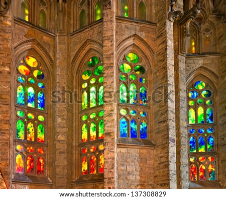 BARCELONA - DECEMBER 14: Colorful window of La Sagrada Familia, the impressive cathedral designed by Gaudi, which is being build since 1882 and not finished yet December 14, 2011 in Barcelona, Spain. - stock photo