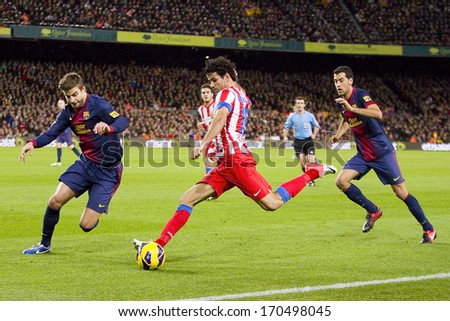 BARCELONA - DECEMBER 16: Diego Costa (middle) in action at the Spanish League match between FC Barcelona and Atletico de Madrid, final score 4 - 1, on December 16, 2012, in Camp Nou, Barcelona, Spain. - stock photo