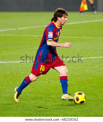 BARCELONA - DECEMBER 13: Leo Messi in action at Nou Camp Stadium. The Spanish Soccer League team FC Barcelona beat the Real Sociedad, 5-0. December 13, 2010 in Barcelona (Spain). - stock photo