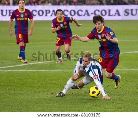 BARCELONA - DECEMBER 13: Leo Messi (10) in action on the soccer field at Nou Camp Stadium. The Spanish team FC Barcelona beat the Real Sociedad, 5-0, December 13, 2010 in Barcelona (Spain). - stock photo