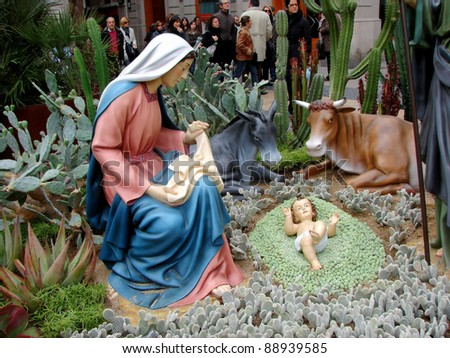 BARCELONA - DECEMBER 3, Maria. Outdoor nativity scene of life-sized figurines on area Sant Jaume, December  3, 2009 Barcelona, Spain. Author of project Association Nativity scene Barcelona - stock photo