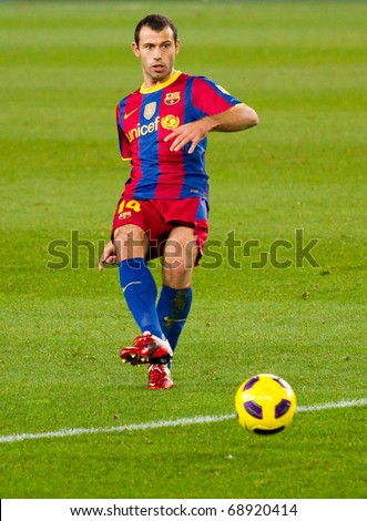 BARCELONA - DECEMBER 13: Nou Camp soccer stadium, Spanish Football League match: FC Barcelona - Real Sociedad, 5 - 0. In the picture, Mascherano in action. December 13, 2010 in Barcelona (Spain). - stock photo