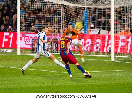 BARCELONA - DECEMBER 13: Nou Camp stadium, Spanish League match: FC Barcelona - Real Sociedad, 5 - 0. In the picture, Andres Iniesta shooting a goal. December 13, 2010 in Barcelona (Spain). - stock photo